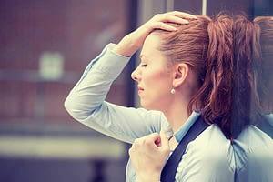 woman with headache has an opiate addiction