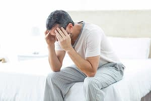 man with headache has psychological dependence
