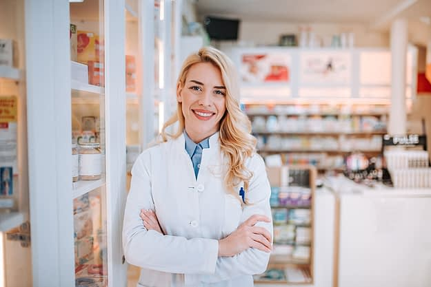 a doctor smiles as she thinks about todays most prescribed drugs