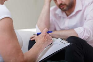 man receives psychotherapy for addiction