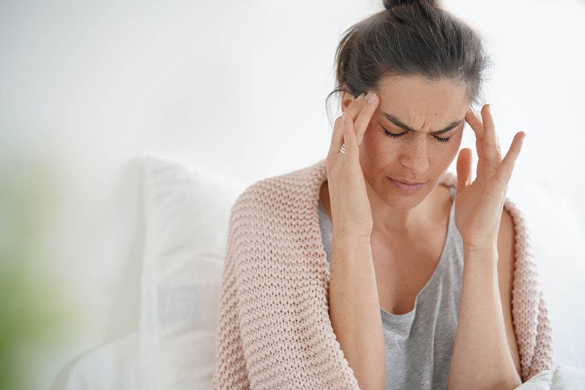 woman thinking about various drug withdrawal symptoms
