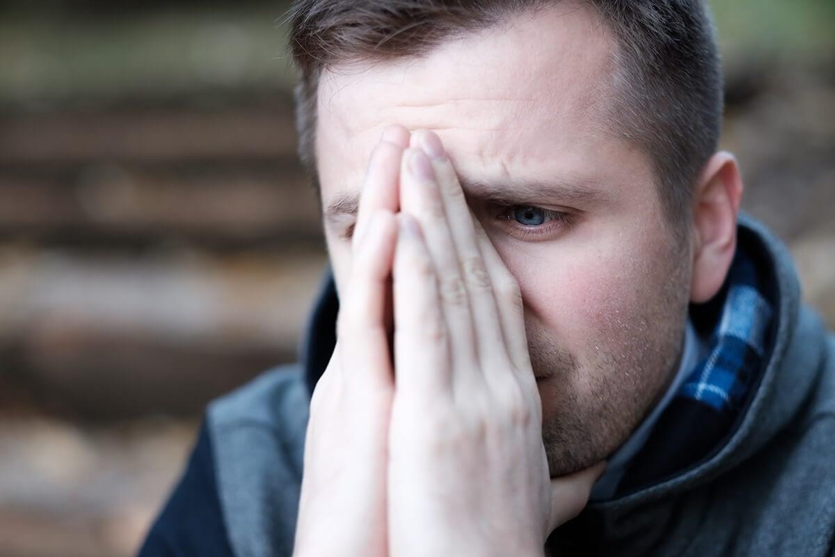 upset man wondering is addiction a choice