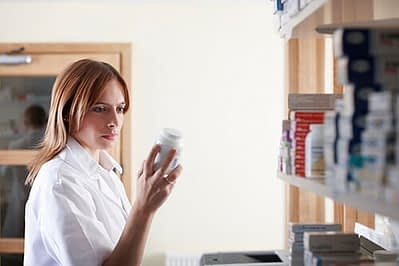 woman looking at drug bottle wonders what is physiological dependence