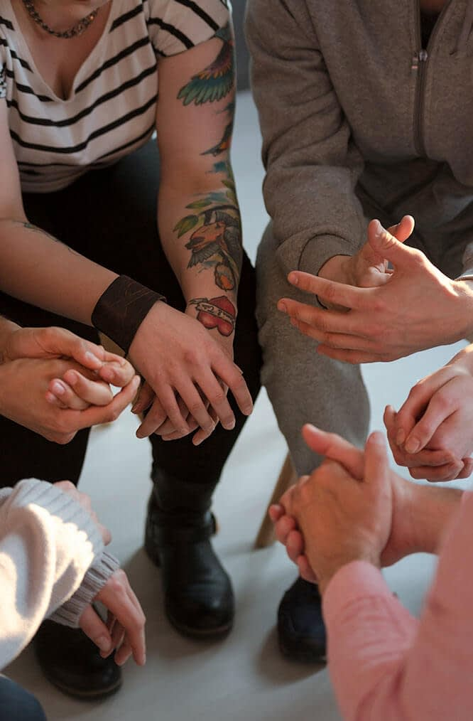 a group of people discuss teen drug addiction