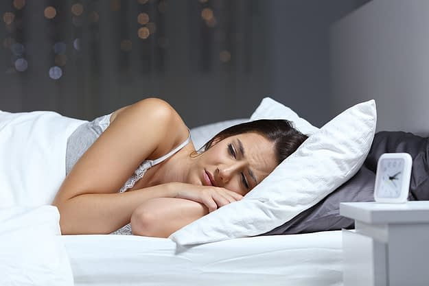 a woman sleeps restlessly as she dreams about the effects of drugs on the body