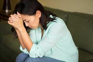 miserable looking woman begins heroin detox