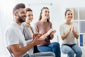 a group therapy session welcoming a new member at Grants Pass Oregon Drug Rehab Center