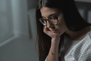 pensive woman wonders about drug withdrawal definition