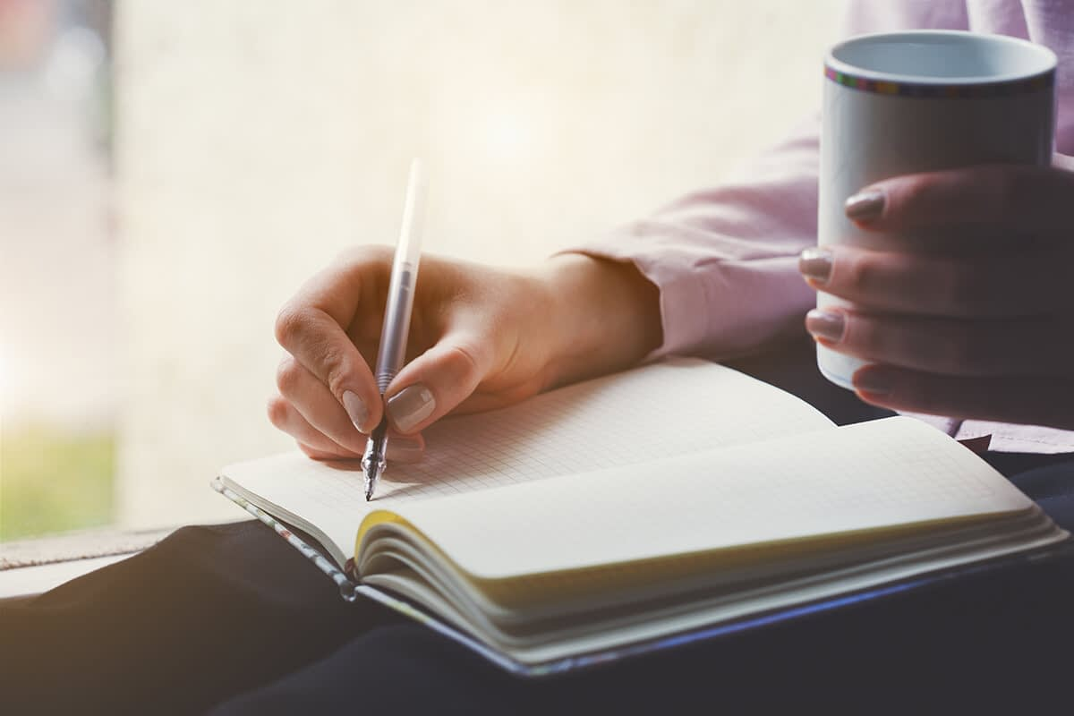 person journaling in recovery