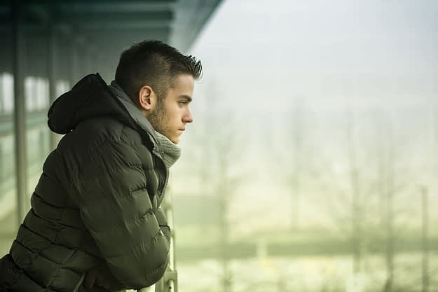man thinking about struggling with mental health during the winter
