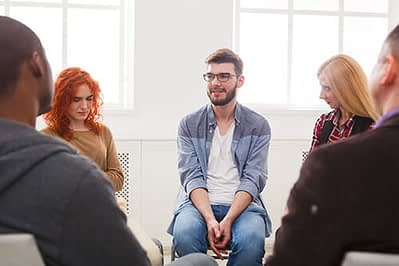 people talking at young adult rehab program