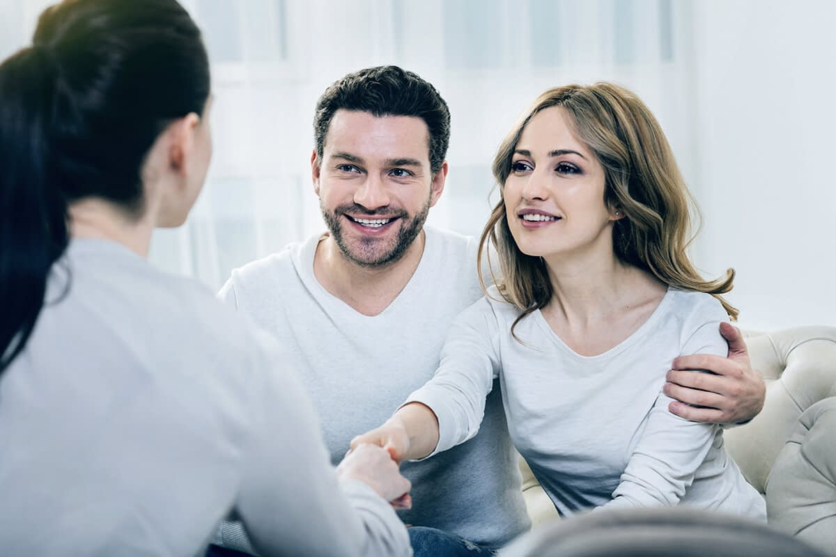 man and woman talking about addiction recovery programs with a professional