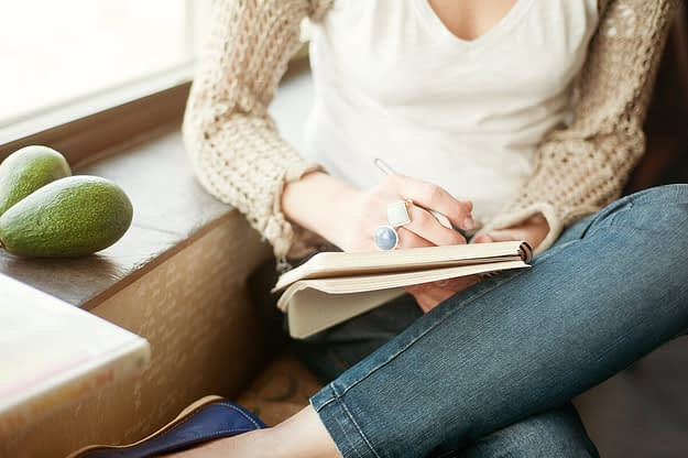 a woman writes down how to construct an addiction treatment plan
