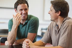 Two guys chatting at a mens rehab program in Oregon.