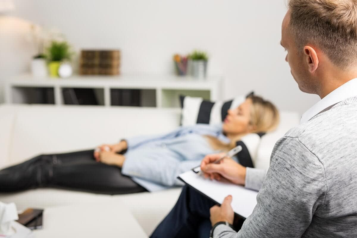 Woman trying hypnosis for addiction