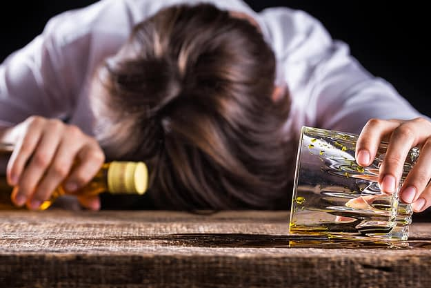 woman suffering from the biological effects of alcoholism