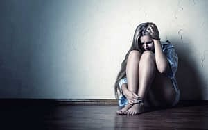 young woman experiencing withdrawal wonders about drug addiction definition