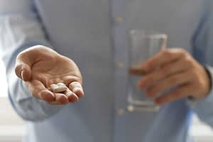 man with pills in hand has painkiller addiction