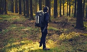 client at drug rehab center near Benton City, Washington hiking through the woods