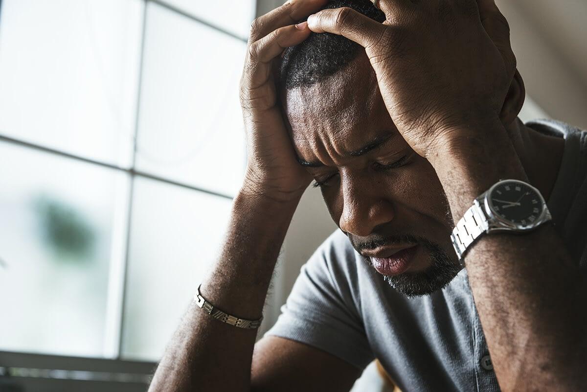 distraught man during stress awareness month
