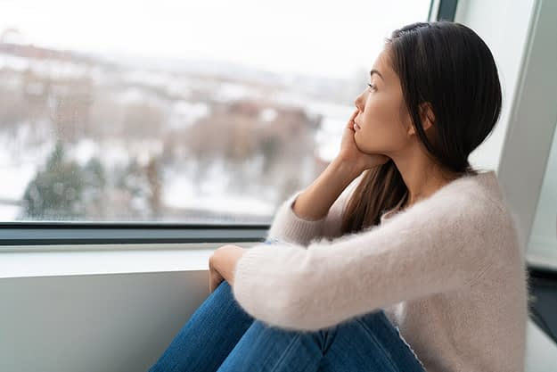 woman with a substance induced mood disorder looking out window