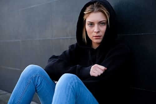 young woman in black hoodie has heroin side effects