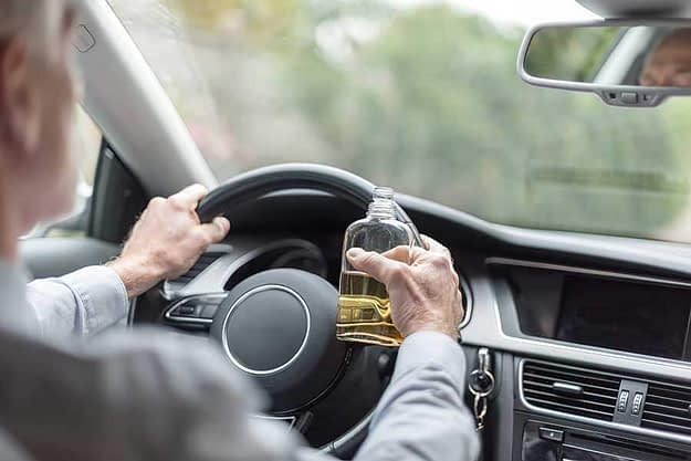 man is drinking and driving
