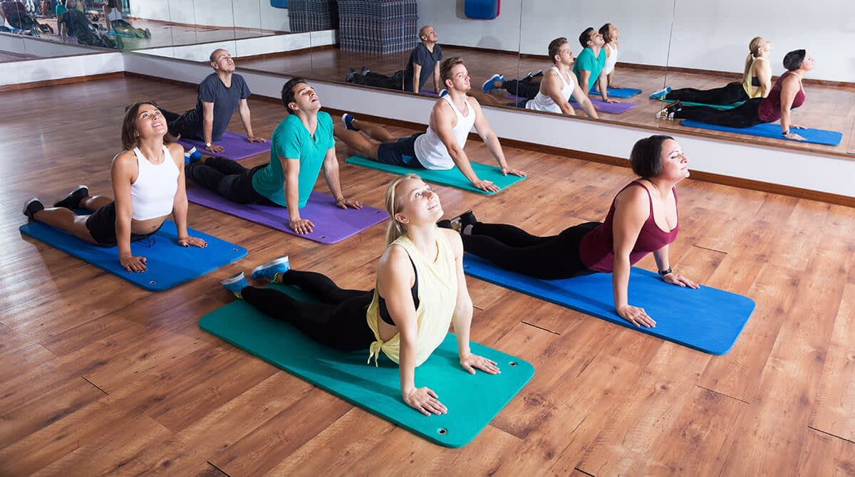 group showing the benefits of yoga in recovery