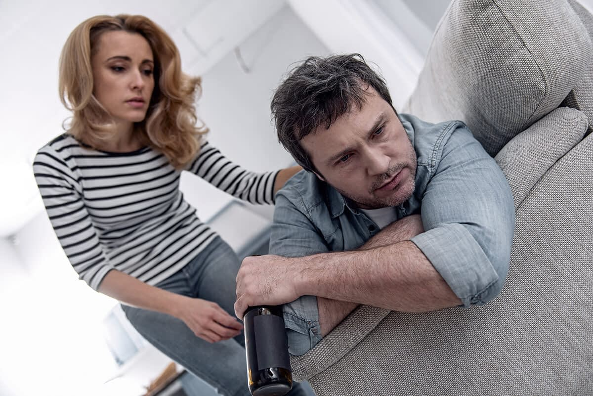 a wife comforting her husband before he starts drunkorexia treatment