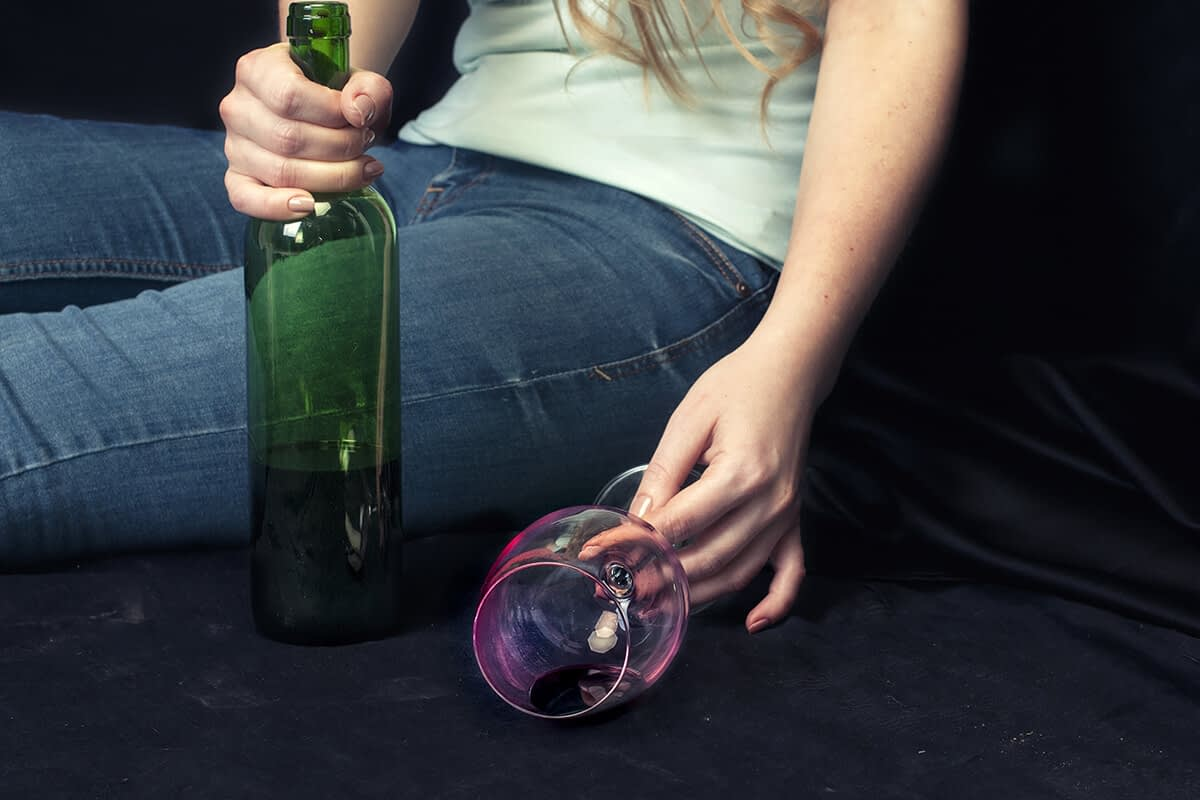 woman showing connection between women and alcoholism
