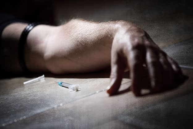 a man lying next to a needle thinks about the opiate overdose timeline