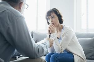 a woman talking to her therapist at a Drug Rehab Center near Bainbridge