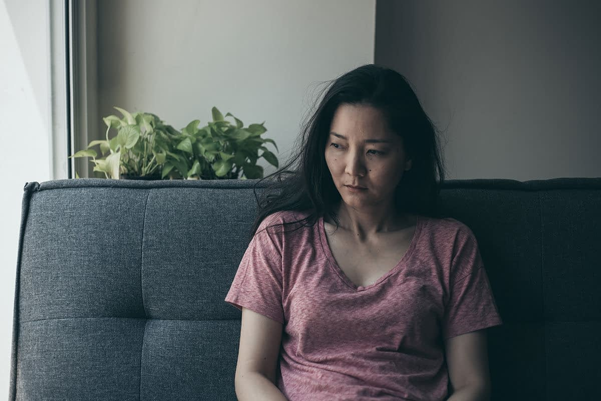 woman thinking about the signs of an anxiety attack