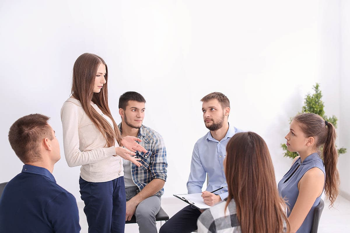 group in a recovery program discussing outpatient treatment and your job
