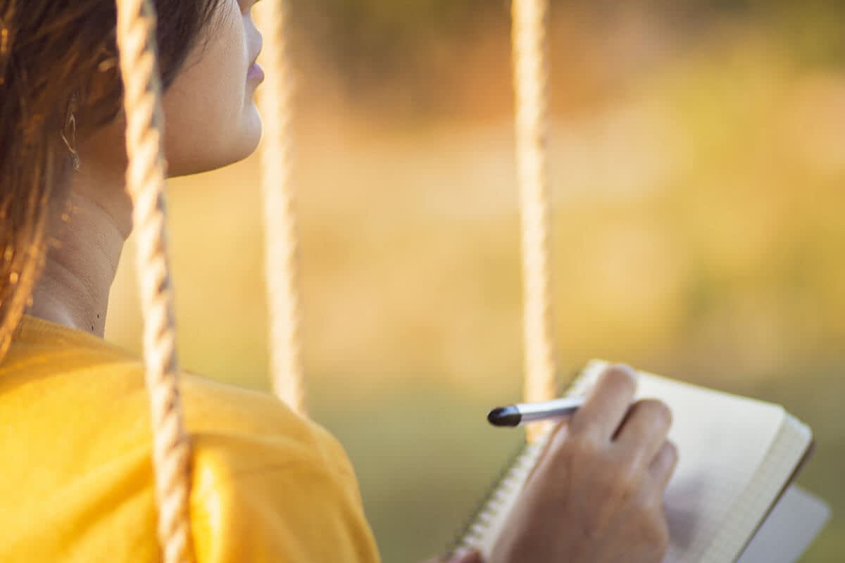 woman writing to form healthy habits in recovery