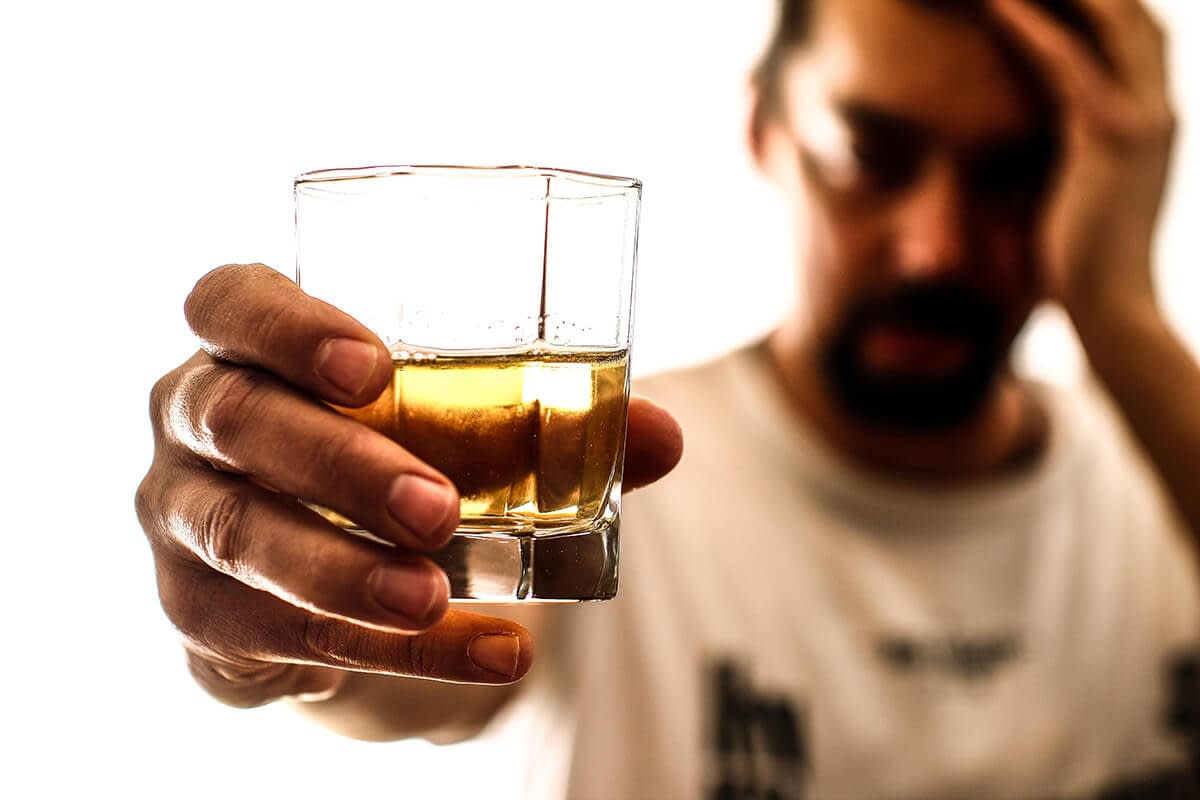man resisting his drink on national alcohol screening day