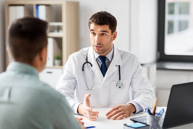 doctor and a patient learning more about alcohol liver damage