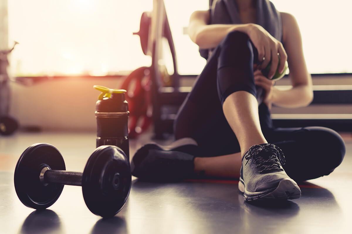 woman using a gym membership