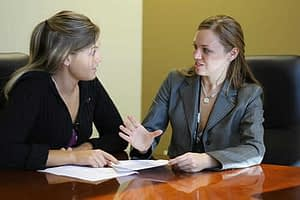 woman talks to therapist about evidence based practice
