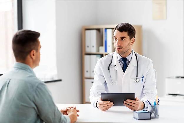 a man asks his doctor for drug addiction help
