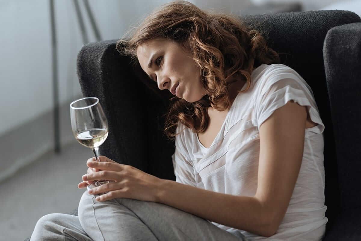 drunk woman on floor wondering is alcohol a depressant