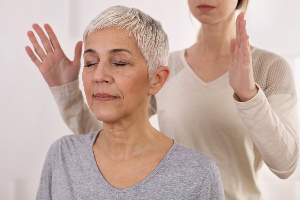 woman learning about the benefits of holistic drug rehab therapy