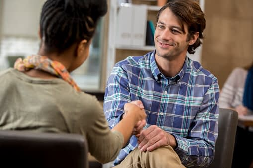 patient talks to counselor during dialectical behavioral therapy in mens drug rehab program