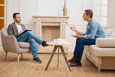 man undergoes gestalt therapy with counselor