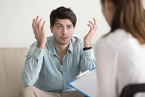 a man confused by a doctor suggestion at a Drug Rehab Center near Redmond