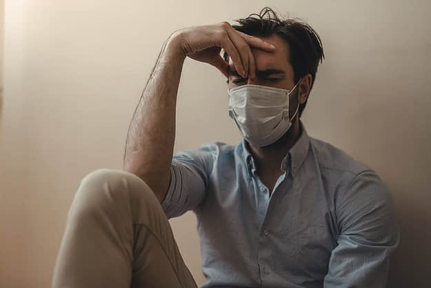 man suffering from drug overdoses and coronavirus