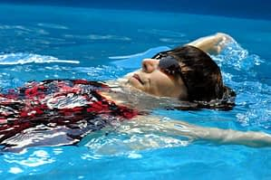 man swimming in aquatic therapy program crestview recovery center