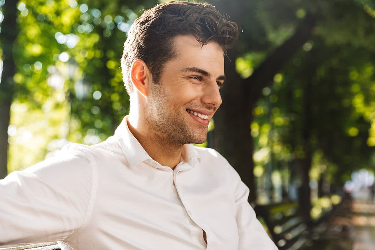 a man smiles as he enjoys sober living