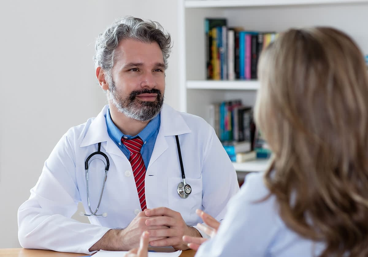a woman asks her doctor how long is outpatient drug rehab