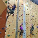 a group climbing at portland rock gym